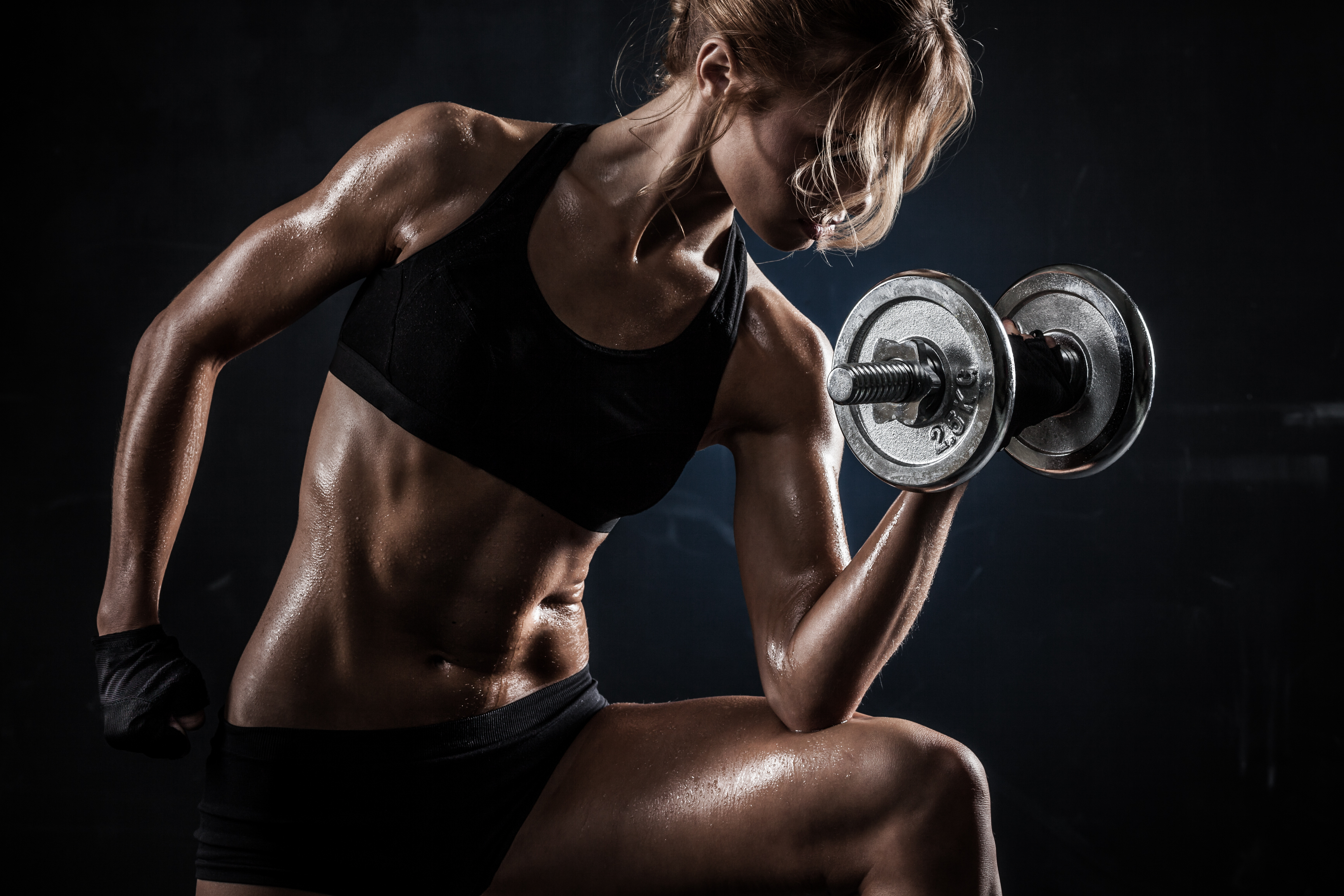 Woman lifting weights with a dumbell